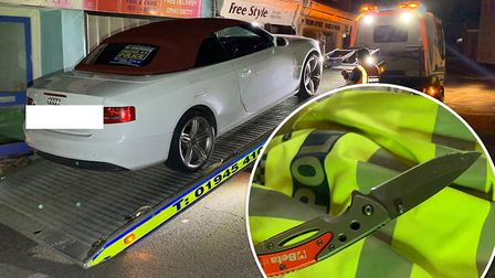 The driver of the Audi was caught on CCTV trying to hide a knife before drug-driving arrest. Picture