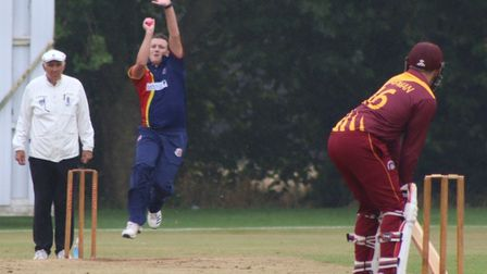 Kieran Haynes leads the bowling attack for Wisbech against March. Picture: DAN MASON