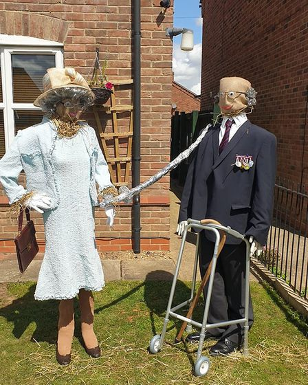 The Queen and Captain Tom on (Hungate Road).