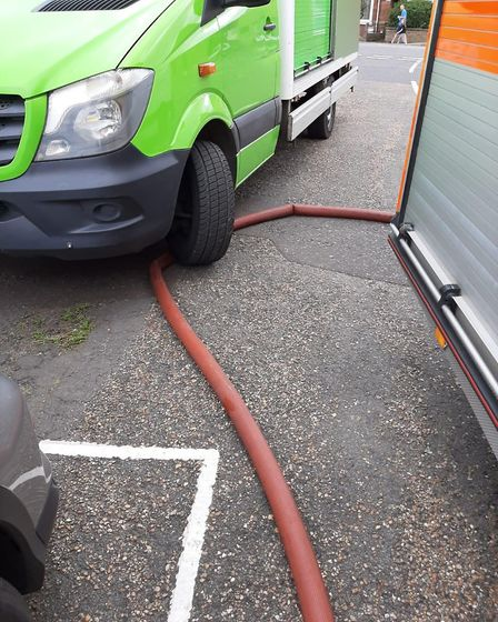 The bright green supermarket delivery van parked on a fire engine hose in Wisbech – cutting off the
