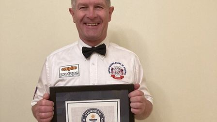 Lee Cook with his Guinness World Records certificate. Picture: LEE COOK