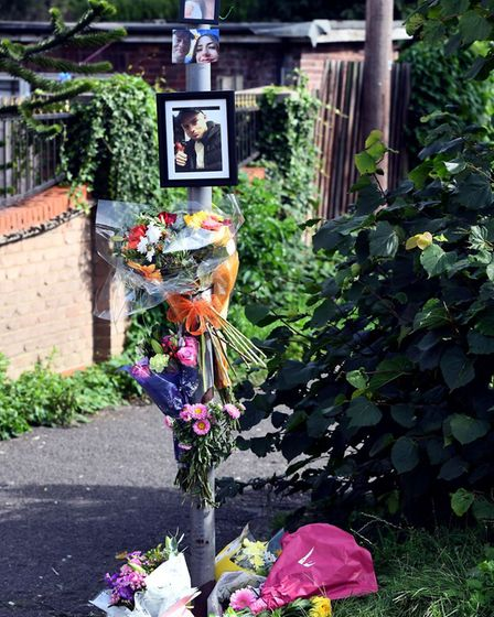 Floral tributes near the spot on Norwich Road, Wisbech, where 23-year-old Tom Lewis was stabbed. He