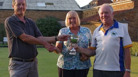 Husband and wife duo Ken & Shelagh Jones presented with the couples trophy by chairman Perry Hall (l