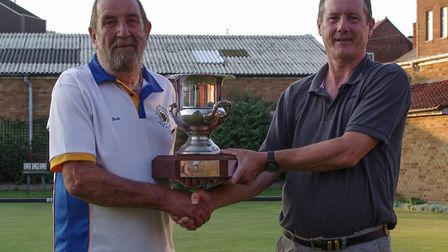 John Rowland (left) is presented with the singles title by chairman Perry Hall. Picture: ALEXANDRA R