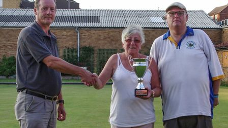 Allan Clarke and Marilyn Hawkins (right) are presented with their pairs trophy. Picture: ALEXANDRA R