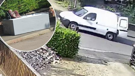 A man was caught on CCTV leaving a large fridge and childs car seat in the middle of the path at Bax
