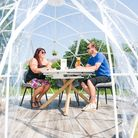 Owner, Josh Green & his mum Sophie Green inside one of the outdoor dining pods at The Barn Restauran