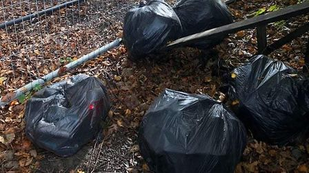A suspected fly-tipper has been rumbled after a name and address were found inside rubbish bags dump