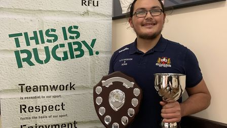 James Cox with the Wildcats' player of the year award and the chairman's cup. Picture: WISBECH RUGBY