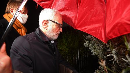 Former Labour leader Jeremy Corbyn arrives at his house in North London. Mr Corbyn has been suspende