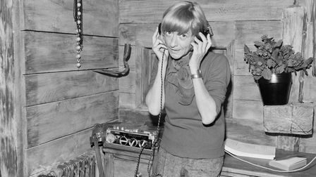 French author-turned-director Francoise Sagan listens to music on the film set of her first film Les