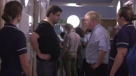 """Boris Johnson was interrupted in his visit to a hospital by a parent angry at """"years and years and y"""