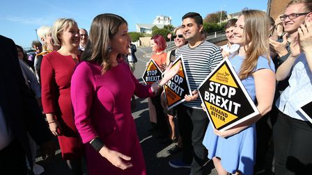 Liberal Democrat leader Jo Swinson (centre) is greeted by party members as she arrives for the Liber