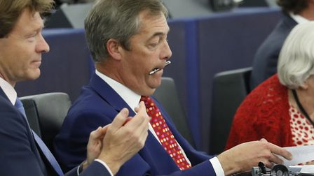 Brexit Party leader Nigel Farage bites a pen during a session at the European Parliament. (AP Photo/