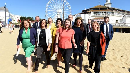 Liberal Democrat leader Jo Swinson and fellow MPs take a walk on Bournemouth beach before her speech