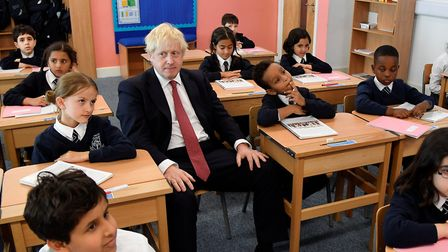 Prime minister Boris Johnson during the visit to a primary school. Photograph: Toby Melville/PA.