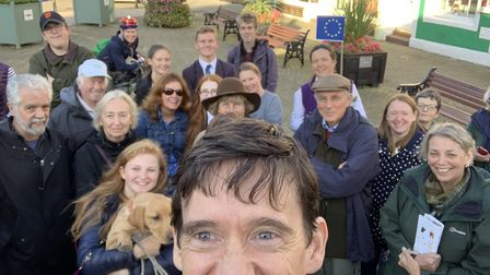 Former Tory leadership candidate Rory Stewart takes a photo with supporters on the campiagn trail. P
