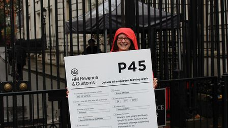 An activist tries to deliver Boris Johnson his P45. Photograph: Kate Plummer/Scram News.