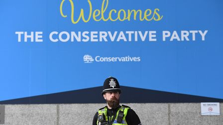 A police officer outside the Conservative Party annual conference. Photograph: Stefan Rousseau/PA.