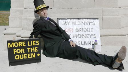 A Jacob Rees-Mogg lookalike campaigns against the prorogation of parliament. Photograph: Aaron Chown