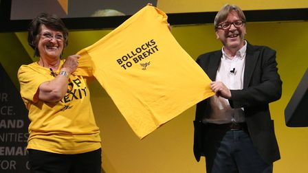 Guy Verhofstadt holds a 'Bollocks to Brexit' t-shirt with Catherine Bearder during Lib Dem party con