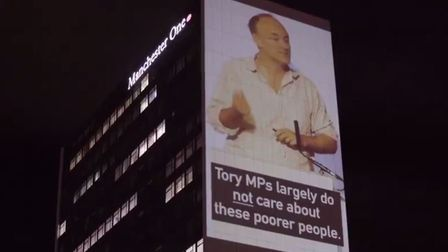 Led By Donkeys have projected footage of Dominic Cummings slamming the Tories on the doorstep of the