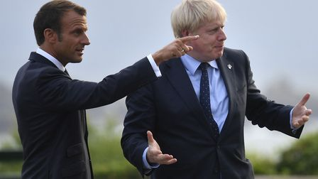French President Emmanuel Macron speaks with prime Minister Boris Johnson. Photograph: Neil Hall/PA.