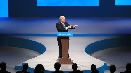Boris Johnson delivers his speech during the Conservative Party Conference at the Manchester Convent
