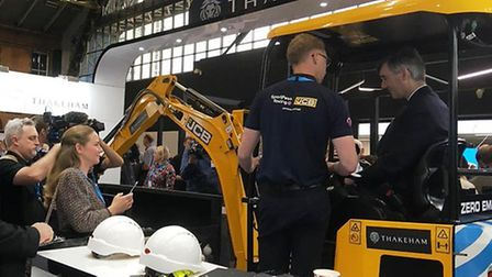 Jacob Rees-Mogg sits in a JCB digger. Photograph: Twitter.