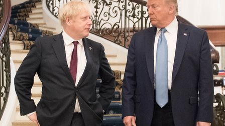 US president Donald Trump and Britain's prime minister Boris Johnson arrive for a bilateral meeting