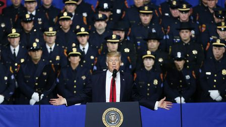 Donald Trump speaks to police officers in Brentwood, New York. Picture: Spencer Platt/Getty Images