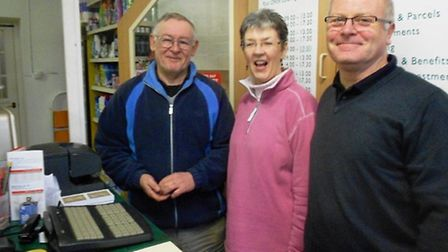 David Lavender (left) with the new owners of Hurford Stores, Terry and Kim Rhodes.