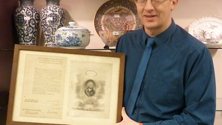 Saleroom manager Brian Goodison-Blanks of Bearnes Hampton and Littlewood pictured with the document