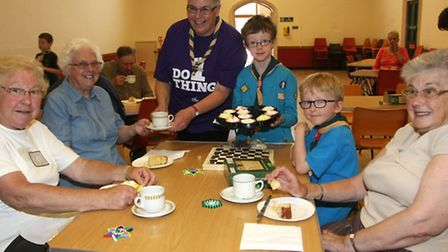 Group scout leader Helen Turner and Beaver Seb Noar at Honiton scouts senior citizens afternoon tea