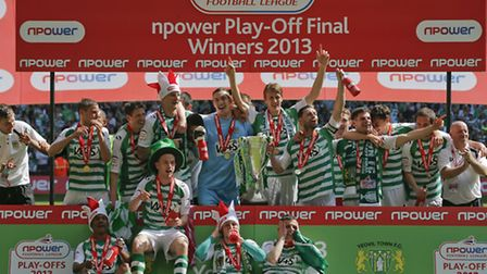 Yeovil Town players celebrate their win over Brentford and promotion into the Championship - Photo