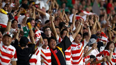 Japanese fans celebrate after their team's first try during the Rugby World Cup 2019. Photo by Clive