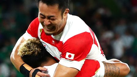 Yu Tamura of Japan celebrates with Lomano Lava Lemeki of Japan following victory in the Rugby World