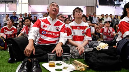 Japanese fans watch the Japan 2019 Rugby World Cup Pool A match between Japan and Russia. Photo: ANN