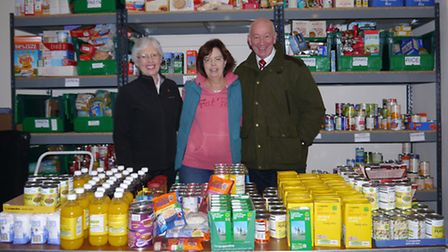 Alan Rowe MBE and his wife Pauline present the much-needed donations to Teresa Hawkes, the co-ordina