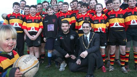 A very pleased looking four year old Beau Lancaster is pictured with players from the Exeter Chiefs,