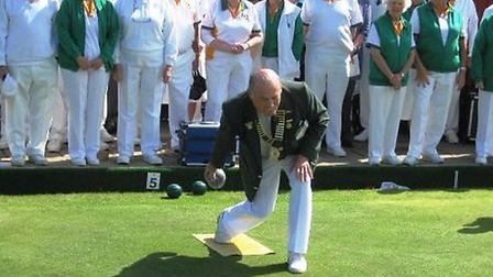 Feniton chairman Mike Chipperfield bowls the first wood of the new season
