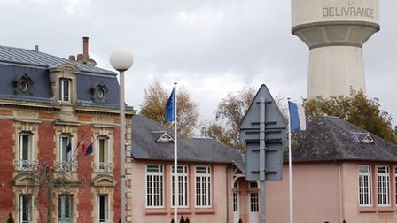 Douvres town hall in the shadow of the water tower. Photo by Chris Carson