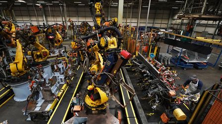 Workers on the production line at Nissan's factory in Sunderland. Picture: Owen Humphreys/PA Wire