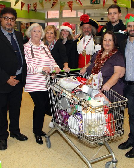 Honiton co-operative hosted a trolley dash in aid of the Honiton Christmas Lights Appeal. The winner