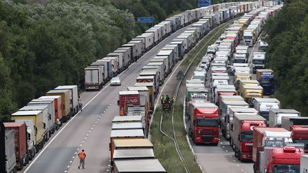 Trucks line up on the M20. (Photo by Peter Macdiarmid/Getty Images)