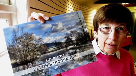 Nicola Russell with the Hidden Gems calendar which raised a massive £5,000 for Axminster's Minster C