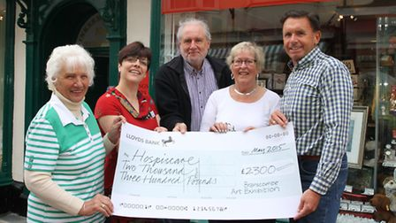 Hospiscare's Sharon Ewart and Eve Deanus from the Seaton Support Group accept a cheque for £2,300 fr