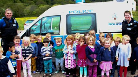 PCSOs Hayley Widger and Andy Trott with the Uplyme pre-school children
