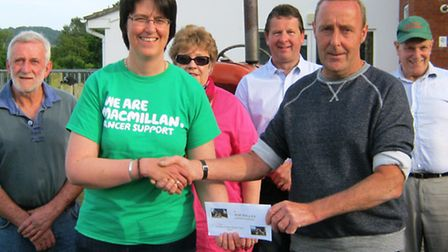 Colyton tractor run committee members hand over a cheque for £3,500 to Macmillan Cancer Support
