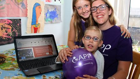 Naomi Gilbert, founding member of Action on Postpartum Psychosis charity, with her daughters Ella, f